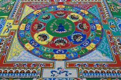 Lama Losang Samten, renowned Tibetan scholar and monk and former attendant to the Dalai Lama, took two weeks to make this Medicine Buddha Sand Mandala at the Museum of Fine Arts in St. Petersburg.  LANCE ROTHSTEIN / STAFF