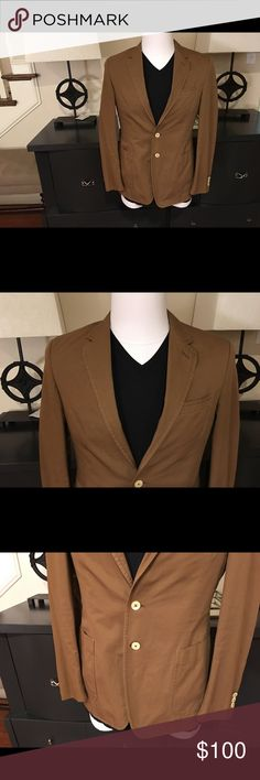 """Prada Men's Blazer Very gently worn great looking Men's Prada 48R Blazer.  This blazer is unlined 2 Button front with pockets. Please note & look at Picture #5, there appears to be a few little """"water"""" spots. They are hardly noticeable and I did not notice them until I looked very very closely. Prada Suits & Blazers Sport Coats & Blazers"""