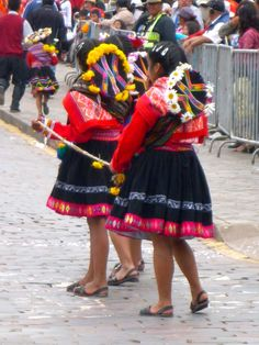Jordan Diflo: This captures two indigenous Peruvian girls dressed in traditional costume to celebrate the annual Carnival festival held every February. The picture was taken in Cuzco, Peru.