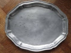 Vintage French large Pewter Etain dish tray charger platter plate serving table display old aged used circa 1950-60's Purchase in store here http://www.europeanvintageemporium.com/product/vintage-french-large-pewter-etain-dish-tray-charger-platter-plate-serving-table-display-old-aged-used-circa-1950-60s/