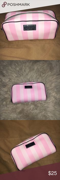 Striped Victoria's Secret makeup bag/pouch. Slight signs of wear. I will clean the inside before shipping out. Smoke free and pet free home Victoria's Secret Makeup Brushes & Tools