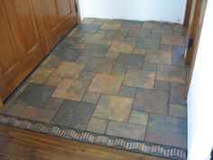 goyer entry floor design pattern | Modified pinwheel design in a tiled entryway.