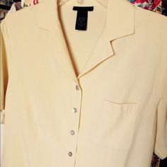 "Butter-yellow blouse - washable silk Beautiful like-new washable short-sleeve blouse EUC. 100% silk! No visible signs of wear, no stains or tears. Single front pocket. Can be worn out or tucked in. Hand washable. Great looking with Anything - dress it up or down! Note color is most similar to fourth photo. Cute paired with Liz Claiborne ""Market"" skirt - check it out in my closet. Silkland Tops Blouses"