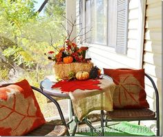 How to make autumn throw pillows, using burlap and spray paint.