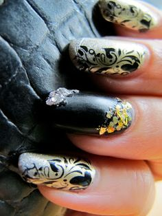 Talon-ted but tawdry: Event Nails in Gold, Silver and Black