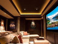 This private theater, a 50th anniversary gift from a very generous son, presented a special design challenge since the theater space had to be built within the limited and odd space of an existing exercise room. Find a home theater professional near you.