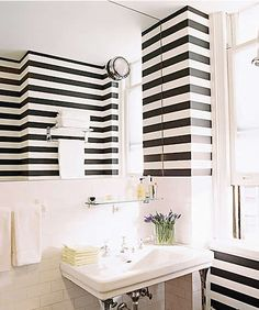 sophisticated stripes + subway tile (via Wall Treatment Design Ideas - Modern Wall Treatments - ELLE DECOR) - reminds me of Syrian houses - which people said was a french influence Striped Bathroom Walls, Striped Walls, White Walls, Bathroom Black, Zebra Bathroom, Master Bathroom, Striped Hallway, Blush Bathroom, Bathroom Store