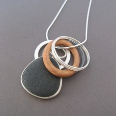 Pebble pendant with wooden hoop | Contemporary Necklaces / Pendants by contemporary jewellery designer Grace Girvan