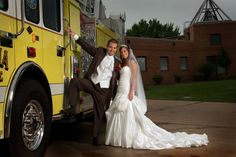 Bride and groom on a firetruck. <3 I so want to do this if I marry a firefighter. Or a cop car with a cop.. Or ambulance with a paramedic... haha I guess I have a thing for heroes. ;)
