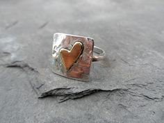 Hand Made Sterling silver square ring with brass heart – Hearts of Brass £14.50. http://www.heartsofbrass.co.uk