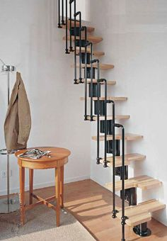 Small staircase - very industrial.. piping and wood.