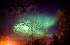 City lights meets the auroras of the night.