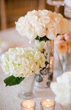 Short white roses wedding reception centerpieces