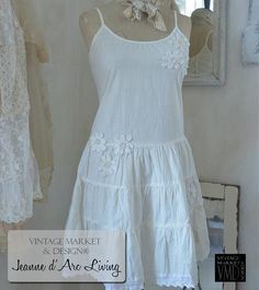 """Jeanne d'Arc Living- Brocante Flowers Dress Nice dress with straps, fine hand made flowers and """"corsage look"""" at the back. Quality: 100% Cotton Color: Cream"""
