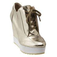 "Boutique 9 sneaker with 4 1/2"" wedge heel & 1 1/4"" lug sole platform."