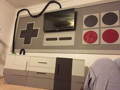 He added a faux bottom to it, blocked it off, and painted the main areas to look like the original Nintendo console.