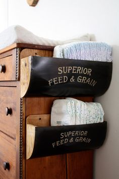 great idea to attach bins to the side of a dresser for changing table