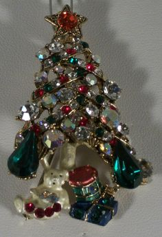 """You are buying my Christmas Tree pin. It has a loop and can also be worn as a pendant. This piece is in excellent condition in everyway. It measures 2 1/2"""" tall. It has a Clear, Green, Aurora Borealis and Red Crystals and is set in a gold plating. 