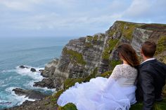 On some cliffs in Southern Ireland (not the cliffs of Moher!!) - See more of our wanderlust wedding photos on our blog www.travelwheretonext.com