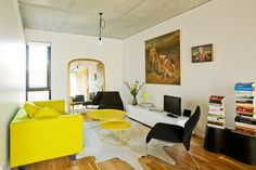 By Chelsea Hing Design Consultants #concrete #ceiling #floorboards #yellow
