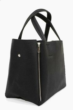 Black pebbled faux leather and impeccable tailoring elevate the Ike Tote above all the rest.