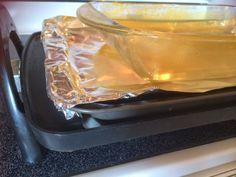 Calentar metal grabado al baño maria sobre placa de cocinar