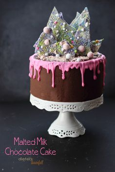 Indulge your sweet tooth with this four layer Malted Milk Chocolate Cake with Chocolate Frosting and beautiful candy bark. A stunning Birthday cake!