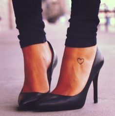 Heart on ankle tattoo.