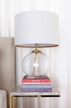 Bedroom styling tip: Stack a lamp on top of hardcover books for a chic bedside table setup. Loving this round Cupcakes and Cashmere seeded glass table lamp from Nordstrom.
