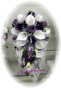 this bouquet has everything I love.  Purple Roses with Calla Lilies. Cascading style!