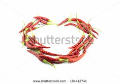 red hot chili pepper make love heart shape on a white background - stock photo