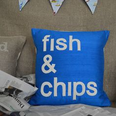 A stunning sapphire blue silk cushion featuring my iconic 'Fish & Chips' design.Both luxurious and modern, this design features a crisp and clean typographic design.  My 'fish & chips' cushion is a best seller and finds homes both in the UK and abroad. Linking together striking contemporary design with a quirky twist on British-ness. Perfect in the kitchen, snug or lounge this has proved a popular gift for house warmings and is perfect for the food-lover in your life. It co-ordinates ...