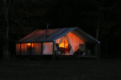 A Davis tent at night - am so phyched.  After loads of searching and researching, I decided on a Davis tent.  Roy Davis was super super helpful - I had so many questions.  The tent  will be very similar to this one with the woodstove and awning.  Now just have to ship it to NZ....