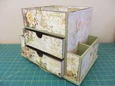 Rotating craft organizer from LAM's Blog (author of Flower Shop Quilts) papered in scrap book papers - 41.95 before decorating materials, but it rotates...