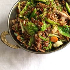 Quinoa with Brussels Sprouts and Pecans: vegetable stock, olive oil, onion, carrots, garlic, mushrooms, pecans, red pepper flakes, soy sauce, lemon