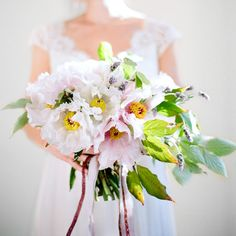 Peony and lavender bouquet fro Joy Thigpen via Once Wed. Photography by Ali Harper.