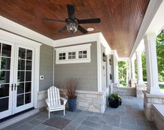 Nantucket Style - LOVE for back patio, nice white trim and French doors. Like light brick in pillars