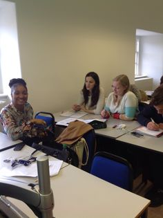Students work out a problem on the Tourism and Hospitality Operations course.