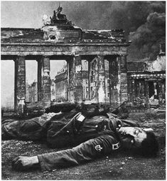 Dead German soldier lies in front of the Brandenburg Gate at the Battle of Berlin 1945.