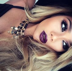 the dark purple ish lip color is so sick! I don't wear lipstick but if I would I would so get this shade. I think I've seen Khloe Kardashian wear a similar shade to this one actually.