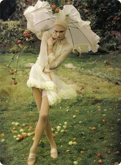 a parasol and a bit of wind. by Tim Walker.