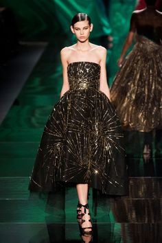 This Monique Lhuillier dress looks like fireworks.  Would love to see this on the red carpet! #MoniqueLhuillier #NYFW #Fall2013