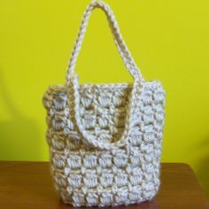 Here is a free crochet pattern for a mini gift bag. The crocheted bag is nice and sturdy and will stand up on its own. It is suitable for giving small gifts or as a little purse for a little girl.