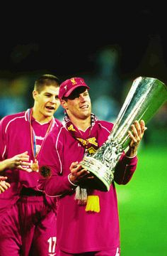 Carra gets his hands on the UEFA Cup following a thrilling 4-3 final win over Alaves in 2001