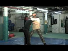 Step in and elbow strike to block a swinging punch. Stewart McGill - Leo Negao | urbankravmaga.com #SelfDefence #KravMaga