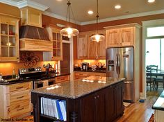 Shaker style cabinetry in the Kitchen of The Birchwood Plan 1239 But with different island