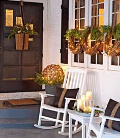 Twinkling lights and flickering candles illuminate a front porch for seasonal sparkle. Add grapevine accents, evergreen clippings and pops of silver to create a warm holiday welcome.