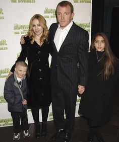 """Madonna fell for fitness trainer Carlos Leon in 1994, and had a baby girl named Lourdes with him in '96. In '98 the pair ended things, with Madonna saying they were """"better off as best friends."""" She met film director Guy Ritchie in '99, and had baby Rocco with him in 2000. They were also married that year."""