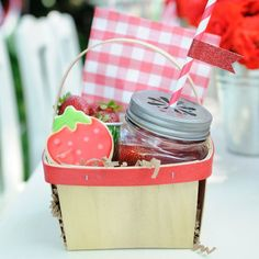 "Strawberry Picnic Wooden Basket  Pack the sweetest lunch with these 1-quart, square wooden berry baskets.  They feature a red band around rim of basket and natural handle, perfect for picnicking, berry picking, or toting home party favors. They measure 5.5"" x 5.75"" x 3.25"" and are sold individually."