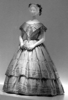 Evening dress Date: 1856–58 Culture: British Medium: silk, cotton, wool Accession Number: C.I.60.26.2a, b
